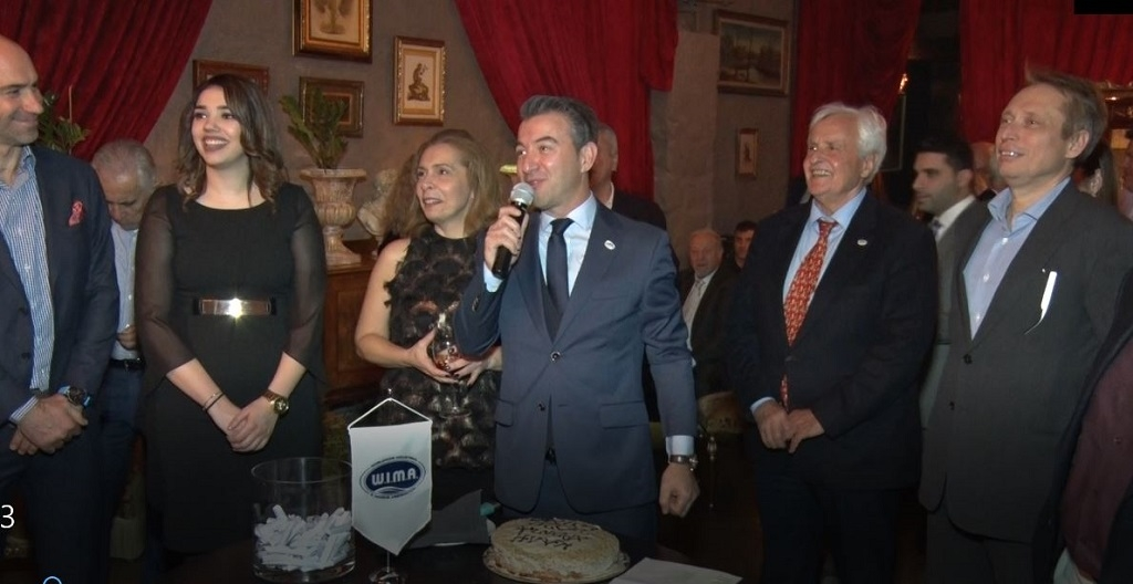 Greek shipping industry representatives exchanged wishes during WIMA's cake cutting